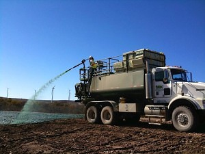 Hydroseeding truck establishing grass in Texas